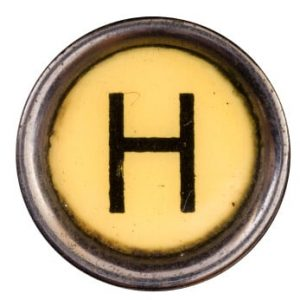 Picture of the letter H from a typewriter button.